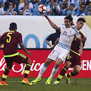 Uruguay Attacker EDINSON CAVANI (21) battles Venezuela Defender WILKER ANGEL (2) for possession of the ball in the first half of a Copa America Centenario Group C match between Uruguay and Venezuela Thursday, June. 09, 2016 at Lincoln Financial Field in Philadelphia, PA.