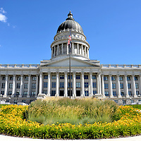 Utah State Capitol Building in Salt Lake City, Utah<br /> There are 52 columns surrounding three sides of the Utah State Capitol in Salt Lake City. The structure&rsquo;s Corinthian style has been compared to the Parthenon in Athens and the Forum in Jerash, Jordan. Finished in 1916, the capitol was built with Utah granite. The copper dome extends 250 feet. Utah became the 45th state on January 4, 1896.