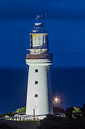 The old 1848 Lighthouse beside the new automated light beacon to the right, a small and much dimmer light but typical of newer beacons now installed in place of the old lamps once whale oil, then kerosene, then electric. <br /> <br /> Taken in the evening twilight with the old tower illuminated by a floodlamp.