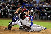 Phoenix, Arizona - Aug 26:  Dodgers  Hanley Ramirez slides home safely in front of D-backs catcher Miguel Montero. (Photo by Jennifer Stewart/Arizona Diamondbacks)