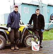 Two men in Newtok, Alaska fixing the board walks. 2008