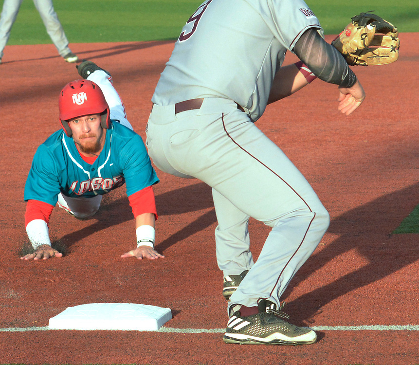gbs041317e/SPORTS --  UNM's Jared Mang slides in safe at third in the first inning of the game at the Santa Ana Star Field on Thursday, April 13, 2017. (Greg Sorber/Albuquerque Journal)