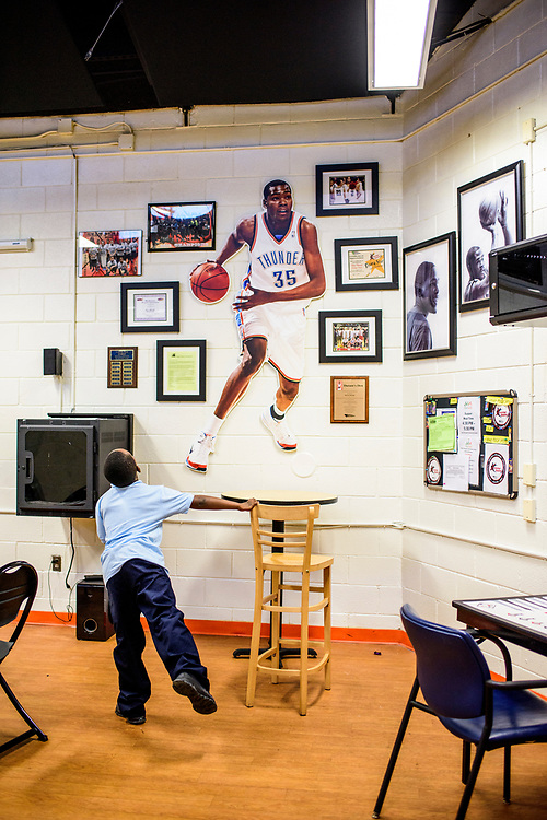 Capitol Heights, Maryland - March 29, 2017: A student sits in the Seat Pleasant Activity Center's Kevin Durant Den March 29, 2017 during the after school program. NBA super star Kevin Durant has donated a substantial amount of money to help renovate the Seat Pleasant Activity Center where he learned to play basketball. Durant's AAU coach and mentor Charles &quot;Chuckie&quot; Craig, who worked at the Activity Center, was gunned down in May 2005 at the age of 35. Durant wears #35 in Craig's honor.<br /> <br /> <br /> NBA Superstar Kevin Durant's jersey number &quot;35&quot; is a tribute to his rec. league coach and mentor Charles &quot;Chuckie&quot; Craig, who was gunned down in at a night club in Laurel, Md., in 2005 when he was 35 years old. <br /> <br /> CREDIT: Matt Roth for The New York Times<br /> Assignment ID: 30204524A