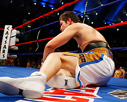 April 12, 2008; Atlantic City, NJ, USA;   Alfonso Gomez gets knocked down during his 12 round WBA Welterweight Championship fight against Miguel Cotto at Boardwalk Hall in Atlantic City, NJ. Cotto won via 6th round stoppage.