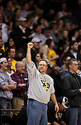 SHOT 2/26/11 4:51:19 PM - A Colorado basketball fan celebrates against Texas during their regular season Big 12 basketball game at the Coors Events Center in Boulder, Co. Colorado upset the fifth ranked Texas 91-89. (Photo by Marc Piscotty / © 2011)