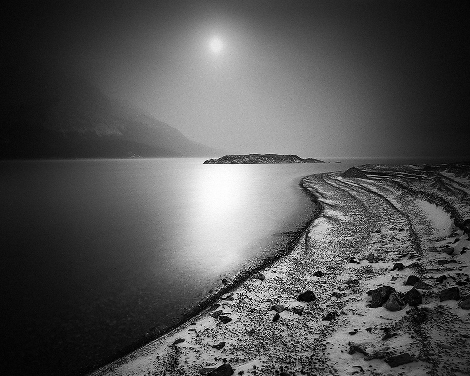 Sun shining through on a foggy day at Abraham Lake in early winter
