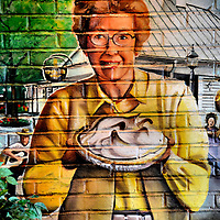 Smiling Mom with Lemon Meringue Pie Mural in Lancaster County, Pennsylvania<br /> The Lancaster County Visitor's Center has the perfect welcome to America&rsquo;s oldest Amish settlement in Pennsylvania Dutch county: a wall mural of a smiling mom holding up a freshly baked lemon meringue pie. While you are at the center, ask for details about several driving tours plus how to find Amish horse and buggy rides, farms, museums, windmills, furniture and crafts along the way.