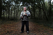 MELISSA LYTTLE   |   Times <br /> Nathan Martin, 72, holds his trust .22 single shot, that was once his father's. He used to hunt hog, deer, squirrel and quail for food, but said he doesn't have it in him to kill anything anymore. He mainly uses the gun for target practice now.