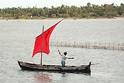 Sailing on boat on Jaffna lagoon. Many of the boats use a red sail. ..2004