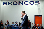 SHOT 3/20/12 1:48:43 PM - Peyton Manning pauses to consider a question as the Denver Broncos introduced the free agent quarterback at a press conference at team headquarters in Englewood, Co. on Tuesday March 20, 2012. Manning is coming off neck surgery and was released by the Indianapolis Colts. He signed a five year, $96 million contract with the Broncos..(Photo by Marc Piscotty / © 2012)