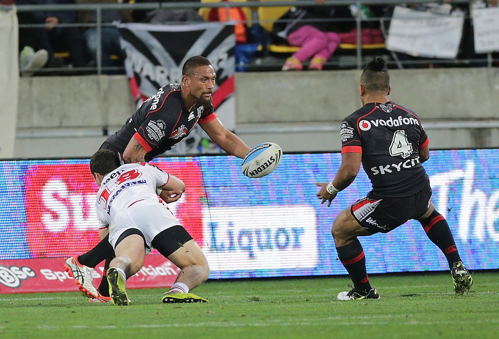 Justin Hunt of the Dragons tackles Manu Vatuvei of the New Zealand Warriors during their round 22 NRL match at Westpac  Stadium, Wellington on  Saturday, August 08, 2015. Credit: SNPA / David Rowland