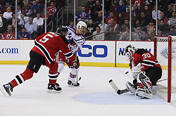 Mar 25, 2010; Newark, NJ, USA; New Jersey Devils goalie Martin Brodeur (30) makes a save on New York Rangers left wing Sean Avery (16) during the second period at the Prudential Center.
