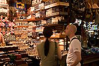 Couple shopping in the Sukiennice Renaissance Cloth Hall Krakow Poland