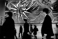 Spector of demise seems to hang over duty-bound commuters in troubled economic times as they pass through Tokyo's Shibuya Station in a dramatic mural by Japanese artist Okamoto Taro in the classic Mexican mural style, Japan.