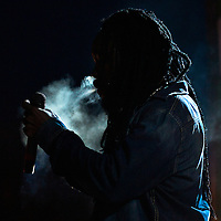 07/30/11 Wilmington DE: Reggae artist Bushman lights up a Joint on stage while performing live at The Bob Marley 17th Annual Peoples Festival Saturday, July 30, 2011, at Tubman-Garrett Riverfront Park in Wilmington Delaware.<br /> <br /> Monsterphoto/SAQUAN STIMPSON