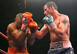 Nov 8, 2008; New York, NY, USA; Joe Calzaghe and Roy Jones Jr. trade punches during their 12 round Light Heavyweight Championship fight at Madison Square Garden in New York, NY.