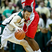 SHOT 2/23/10 9:06:18 PM - Colorado State's Travis Busch tries to dribble past New Mexico's A.J. Hardeman during the first half of their regular season Mountain West Conference game at Moby Arena in Fort Collins, Co. New Mexico survived a tight game winning 72-66. (Photo by Marc Piscotty / © 2010)