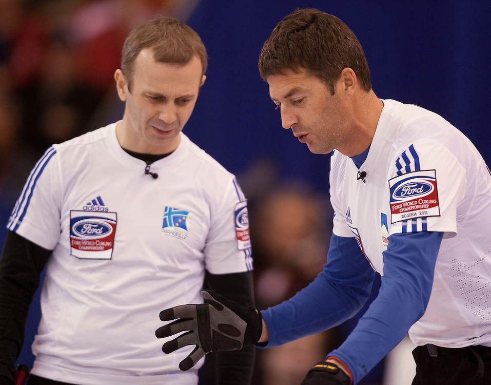 France's skip Thomas Dufor, right, talks with his  second Lionel Roux during their game against the United States during the evening draw at the Ford World Men's Curling Championships at the Brandt Centre in Regina, Saskatchewan, April 7, 2011.<br /> AFP PHOTO/Geoff Robins