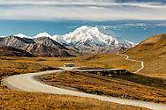 Tour bus at Stony Hill Overlook of Denali in Denali National Park in Interior Alaska.
