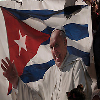(092015  Havana, Cuba) A man, who arrived before dawn at the Plaza de la Revolucion, leans on a banner of Pope Francis while waiting for him to celebrate Mass in Havana, Sunday, September 20, 2015. photo by Angela Rowlings.