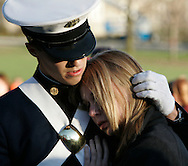 Virginia Tech Cadet Tim McCartin (L) comforts his girlfriend Christine George at a memorial for the victims in the Virginia Tech shootings in Blacksburg, Virginia April 17, 2007.  REUTERS/Rick Wilking (UNITED STATES)