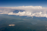 An anvil cumulonimbus incus cloud forms over the Sierra Nevada mountains in California. These clouds can result in lightning, hail, heavy rain and strong wind.