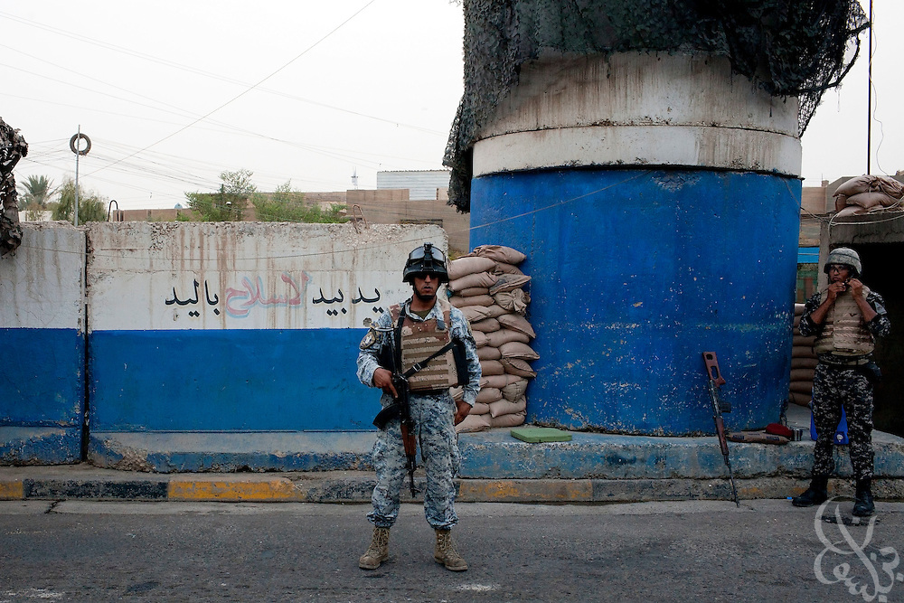 Iraqi Federal Policemen man a checkpoint at the entrance to the Amil neighborhod in Southwest Baghdad, Iraq August 23, 2010.  The number of Iraqi police and army checkpoints across the city has  dramatically increased as Iraqi forces try to gain the upper hand on security now that American combat forces have withdrawn. . .