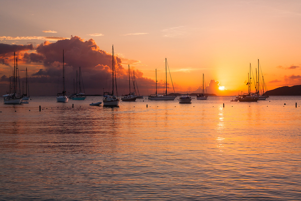Sunset over beautiful Honeymoon Bay on Water Island, the main harbor on this tiny cay, the newest US Virgin Island.