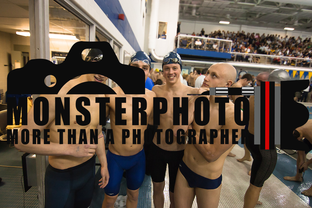 022512 Newark DE: Left to Right Salesianum swimmer Matthew Tankle, Chris Rechione, Matt Stasiunas and Jordan Carely pose for a photo after Salesianum wins the boys 400 yard freestyle relay at the Boys swimming and diving state tournament at Rawstrom Natatorium, Carpenter Sports Building Saturday, Feb. 25, 2012.<br /> <br /> Special to The News Journal/SAQUAN STIMPSON