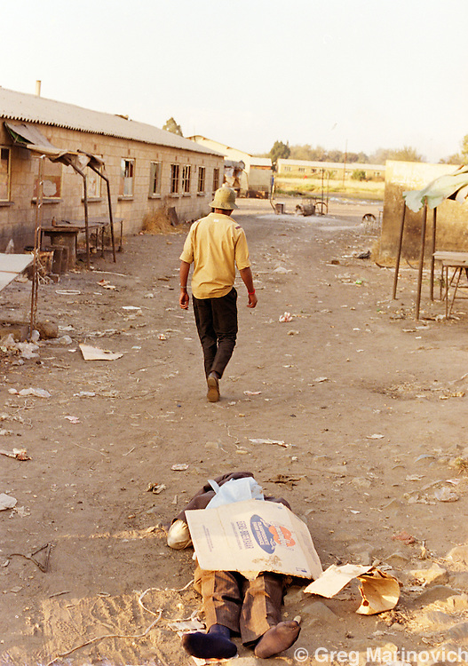 Nancefield, Soweto, Johannesburg. The body of a youth from theresidential houses of the  township lies dead after he came to buy marijuana in Nancefield Hostel, Soweto, 1990. South Africa