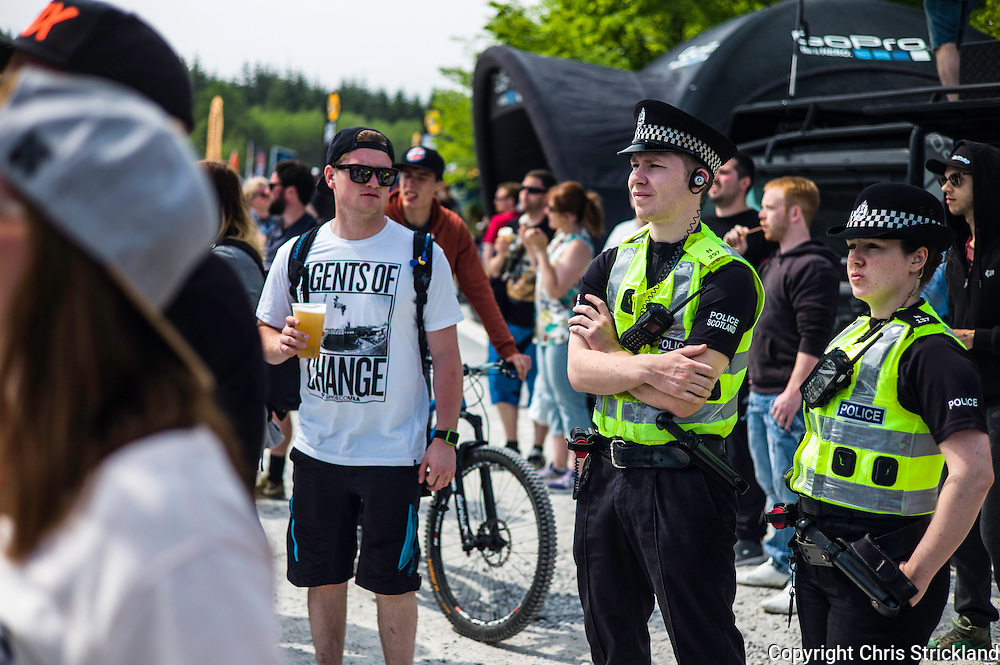 Nevis Range, Fort William, Scotland, UK. 4th June 2016. Police Scotland mingle with the revellers. The worlds leading mountain bikers descend on Fort William for the UCI World Cup on Nevis Range.