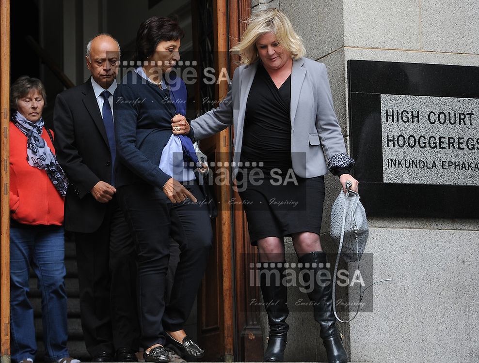 CAPE TOWN, SOUTH AFRICA - Thursday 8 October 2014, Mrs Snila Dewani, mother of Shrien Dewani and her husband Prakash (back) leaves court during Day 3 of the Shrien Dewani trial at the Cape High Court before Judge Jeanette Traverso. Dewani is caused of hiring hit men to murder his wife, Anni. Anni Ninna Dewani (n&eacute;e Hindocha; 12 March 1982 &ndash; 13 November 2010) was a Swedish woman who, while on her honeymoon in South Africa, was kidnapped and then murdered in Gugulethu township near Cape Town on 13 November 2010 (wikipedia).<br /> Photo by Roger Sedres