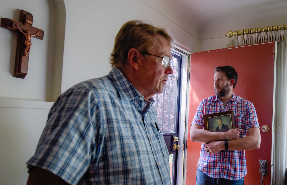 rer042317b/Life/April 23, 2017/Albuquerque Journal<br /> Dan Cornish(Cq),pictured on the right holding a photograph of his grandfather Don Wilson(Cq) will be sworn in as an attorney, he will be the 5th generation of attorney's in his family, dating back to territorial times in NM. Pictured on the left is Dan's father Tim Cornish. <br /> Roberto E. Rosales/Albuquerque Journal
