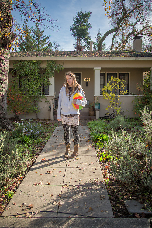 Massage Therapist Ashley Deak in front of her home on Gold Street in Calistoga