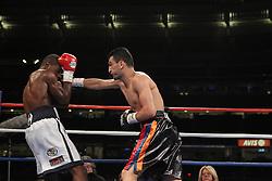 June 5, 2010; Bronx, NY; USA;  Joe Greene (white trunks) and Vanes Martirosyan (black trunks) trade punches during their bout at Yankee Stadium.  Martirosyan won via unanimous decision.