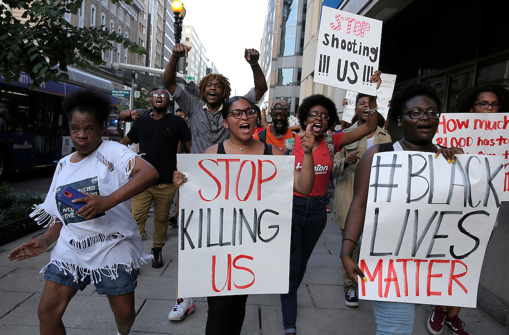 Demonstrators with Black Lives Matter march during a protest in Washington, U.S., July 8, 2016.  REUTERS/Joshua Roberts