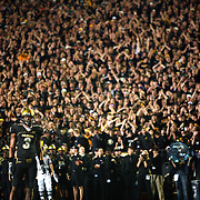 SHOT 9/18/08 9:13:19 PM - Colorado's Jimmy Smith (#3, CB) looks into the backfield while fans cheer in the background as West Virginia breaks the huddle during the second half of their game at Folsom Field in Boulder, Co. Colorado beat the then 21st ranked Mountaineers 17-14 in overtime. Colorado freshman running back Rodney Stewart finished the game with 166 yards rushing..(Photo by Marc Piscotty / © 2008)