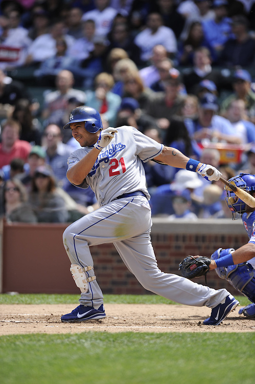 CHICAGO - MAY  04:  Juan Rivera #21 of the Los Angeles Dodgers bats against the Chicago Cubs on May 4, 2012 at Wrigley Field in Chicago, Illinois.  The Cubs defeated the Dodgers 5-4.  (Photo by Ron Vesely)   Subject:  Juan Rivera