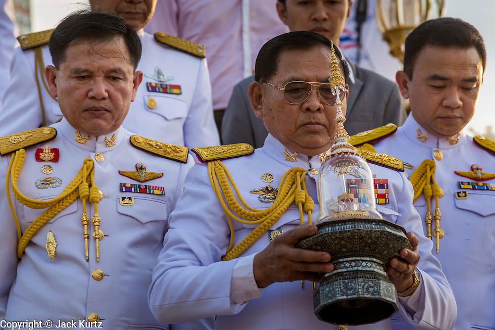 06 JANUARY 2013 - BANGKOK, THAILAND: Thai military commanding generals carry a relic that is a piece of the Buddha's hair out of a shrine at Sanam Luang in Bangkok. The relic has been on display in Bangkok for about 10 years. There was a ceremony in Sanam Luang in Bangkok Sunday to honor the relic. People prayed for it and received blessings from Buddhist monks and Brahmin priests who presided over the service. The hair is being moved to Ayutthaya, where it will be displayed in a Buddhist temple. The piece of hair has been on loan to Thai Buddhists from a Buddhist temple in Sri Lanka.    PHOTO BY JACK KURTZ