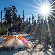 Tent under sun starburst. Backback to Mirror Lake in Eagle Cap Wilderness,  Wallowa–Whitman National Forest, Wallowa Mountains, Columbia Plateau, northeastern Oregon, USA. Hike 7.3 miles from Two Pan Trailhead (5600 ft) up East Lostine River to camp at popular Mirror Lake (7606 ft). Day hike to Glacier Lake via Glacier Pass (6 miles round trip, 1200 ft gain). Backpack out 8.7 miles via Carper Pass, Minam Lake and West Fork Lostine. From September 11-13, 2016 Carol and I walked 22 miles in 3 days.