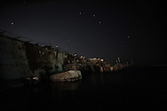 Libya, Tripoli: A sunken by 2011 NATO airstrikes warship lies on a side in the NAVI port of Tripoli.  Alessio Romenzi