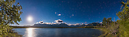 Moonlight at Maskinonge Pond in Waterton Lakes National Park, Alberta, with a nearly Full Moon over the pond, and a deep blue moonlit sky with Mars and Saturn at centre in Scorpius. <br /> <br /> This is an 8-panel panorama stitched in Photoshop with Photomerge - oddly ACR refused to stitch this despite the good overlap.