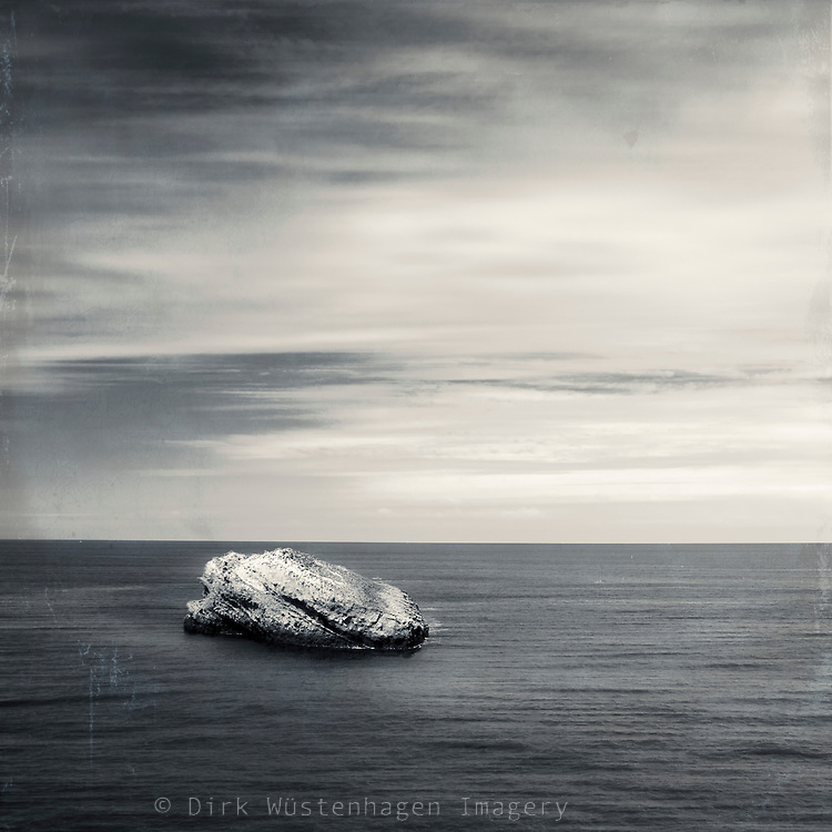 Rock in the sea off the coast of Biarritz/France. manipulated photo.