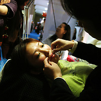 BEIJING, 22. October 2004 : a woman enjoys a facial treatment by a professional at the International Beauty Week in Beijing, October 22, 2004, in China. Beauty business is booming in China. Sales in beauty related businesses and products are worth more than 7 billion USD last year.      ..Whereas in Mao Zedong's China, even pigtails were seen as a sign of vanity (and had to be cut off) , nowadays, urban Chinese women seek about every means in order to distinguish themselves from the masses.  This year Beijing will organize the worl'd first beauty pageant for women had had plastic surgery in early December...