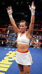 Noriko Kariya, sister of NHLer's Paul and Steve Kariya, poses after her 4 round unanimous decision win over Maria Lucy Contreras.  With the win, Kariya remained undefeated and moved her record to 4-0.  The bout took place on the undercard of the Arturo Gatti vs Thomas Damgaard IBA Welterweight Championship bout at Boardwalk Hall in Atlantic City, NJ.