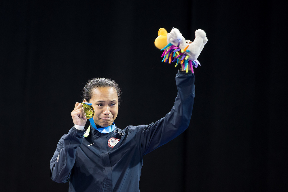 A tearful Paige McPherson of the United States weeps as she celebrates her gold medal during the medal ceremony for the women's taekwondo -67 kg division at the 2015 Pan American Games in Toronto, Canada, July 21,  2015.  AFP PHOTO/GEOFF ROBINS