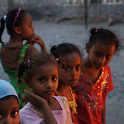 Girls gather at a school that serves as a camp for internally displaced people in Aden, Yemen, March 17, 2012. More than one hundred families stay at the school. They fled the province of Abyan, torn by fighting between al Qaeda-linked militants and government forces.