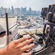 CAPTION: This is one of the tools used by the Operations and Warning Division to collect real-time data on rainfall and wind direction. It is entirely solar powered. LOCATION: Disaster Risk Reduction and Management Office, Makati, Philippines. INDIVIDUAL(S) PHOTOGRAPHED: N/A.