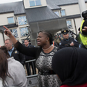 Nekima Levy-Pounds, president of the Minneapolis NAACP, leads protestors with the Black Lives Matter movement protest in a prayer and chanting outside the Minneapolis Police Department 4th precinct headquarters, after activists who had been camped out in the front entrance to the precinct were cleared out on Wednesday, November 18, 2015 in Minneapolis, Minnesota. <br /> <br /> She said, &quot;Lord, raise up the leaders who will rule this city with integrity ,fairness and justice. And we pray that you will stir out spirits,  that we be willing to come back, time and time again, until we get the justice we&rsquo;re seeking.&quot; <br /> <br /> Protests and the encampment came in reaction to the shooting of 24-year-old Jamar Clark by Minneapolis Police on Sunday. <br /> <br /> <br /> Photo by Angela Jimenez for Minnesota Public Radio www.angelajimenezphotography.com