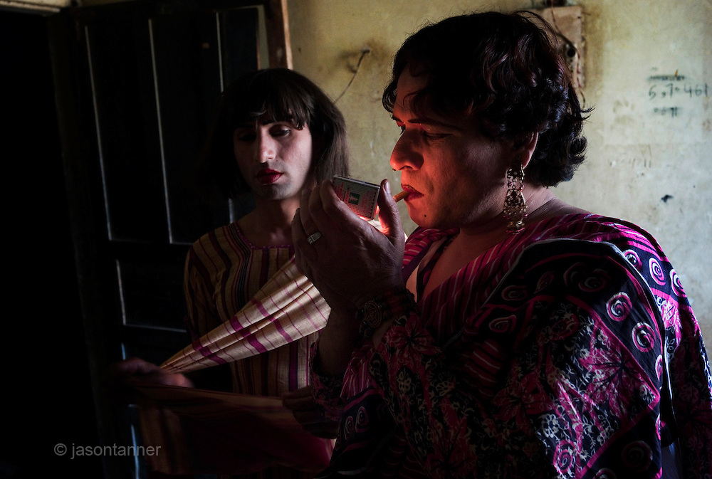 Sheza Shahnawaz, a 42 year old Hijra is the Guru (leader) and Sonya, a 32 year old Hijra in make up for the evenings work on the streets of Karachi...The word Hijra is an Urdu word meaning eunuch or hermaphrodite. However, most Hijras in Pakistan are gay men who leave home to join the Hijra community as young boys where there is more acceptance. Most identify themselves as more feminine then masculine and dress and act accordingly...Although tolerated in a country where homosexuality is against the law, Hijras are largely ostracised from society. They are often denied work opportunities, rejected by most families, lack formal education and live in poorer areas of the city...They share similarities with the more famous Hijra communities in the Indian subcontinent and Bangladesh. In a continent where great emphasis is placed on one's ability to have children, those who are unfortunate not to be able to conceive children are not considered a true man or woman. Life for many Hijras in Pakistan consists of begging for alms (Zakat) in the more prosperous areas of the city as well as slums in addition to receiving alms when bestowing blessings on male babies and at weddings....Most Hijras dress as women, and engage in activities such as dancing and entertaining in public - activities that would be considered inappropriate for women of the subcontinent. Some members of the community engage in prostitution. .